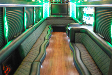 As You Can See The Interior Of Our 26 Passenger Bus Has Custom Leather Seating Wood Floors A Large Flat Screen Tv Privacy Shades